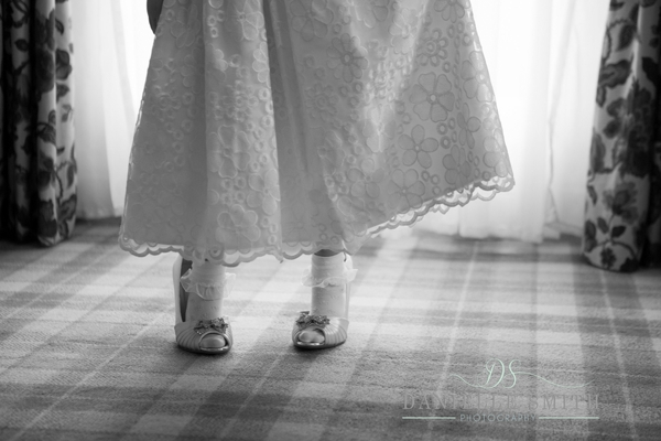 flower girl wearing brides shoes at down hall