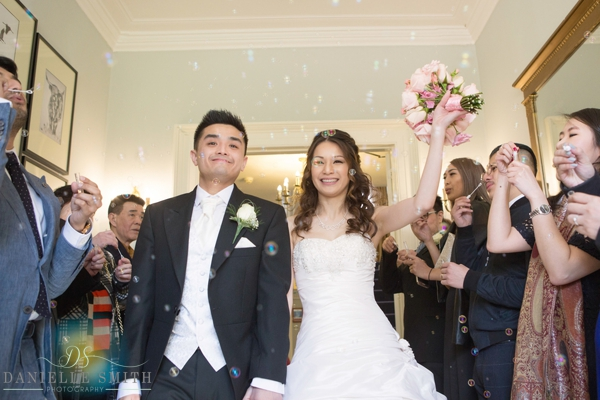 bride and groom with bubbles at the fennes