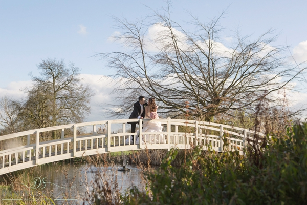 bride and groom on bridge at the fennes