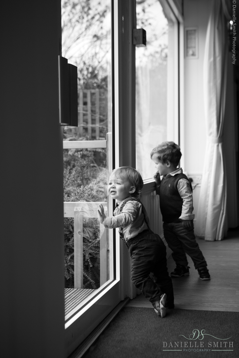 little boys looking out the window