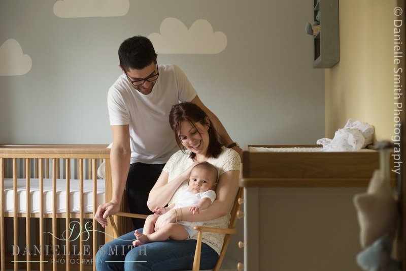 mum and dad with baby in nursery - chelmsford lifestyle photographer