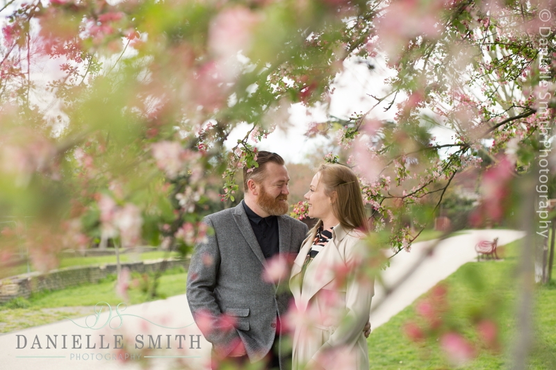 couple with blossom in raphaels park