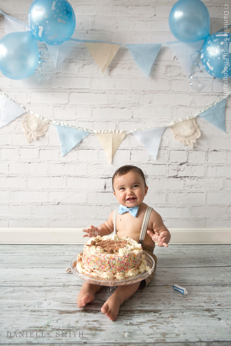 little boy excited for cake smash