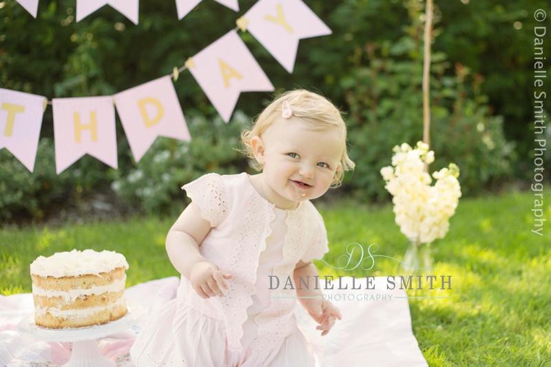 little girl dancing at outdoor cakesmash