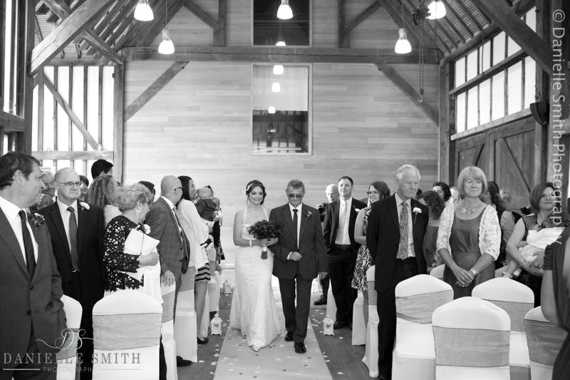 dad walking daughter down the aisle at barn wedding