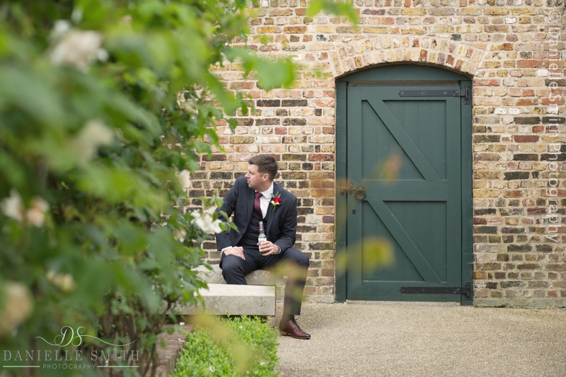 groom sitting having a beer in the garden