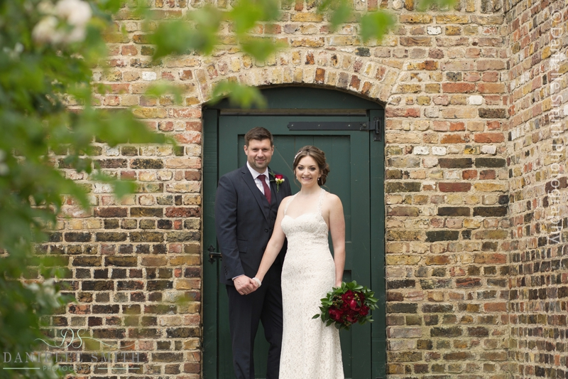bride and groom in walled gardens - barn wedding in purfleet