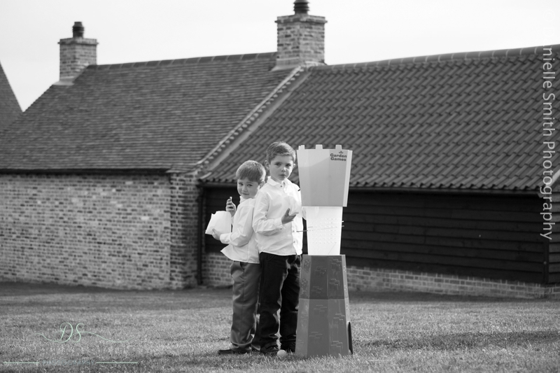 little boys playing garden games - barn wedding in purfleet
