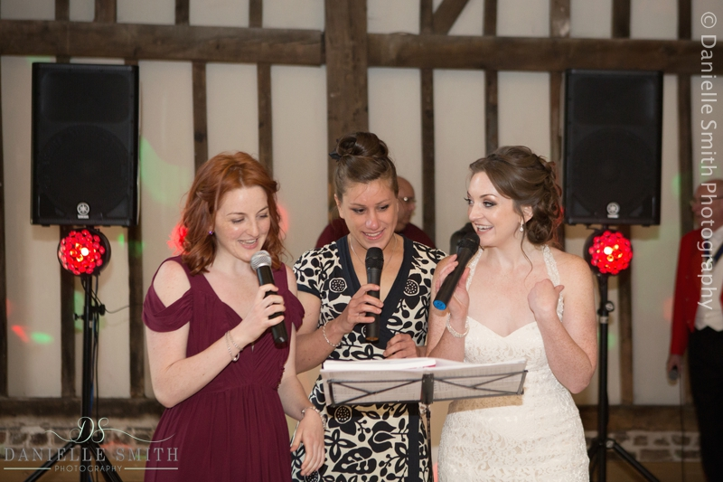 bride and her friends singing at wedding