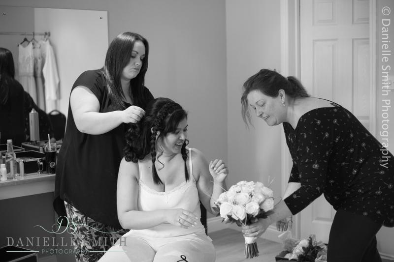 bride looking at her wedding flowers