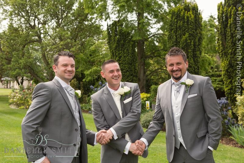 groom shaking best mens hands