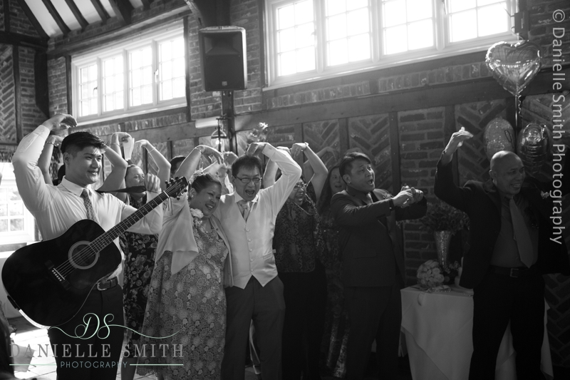 family perform song and dance at wedding