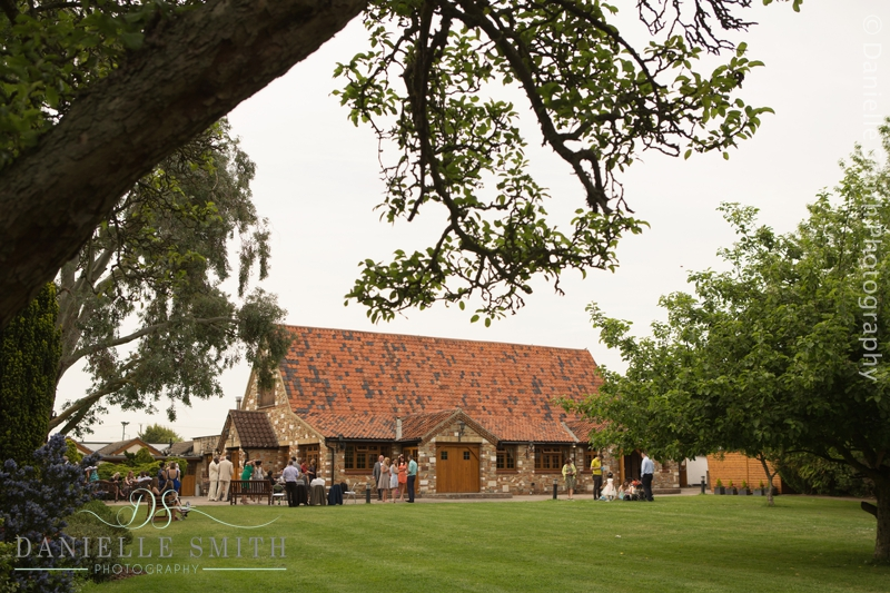 wedding guests and exterior of barn at ye olde plough house