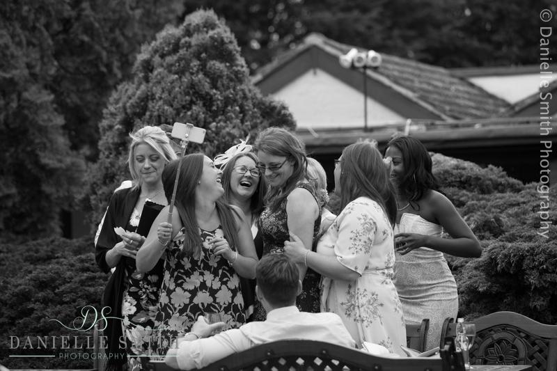 group of friends having selfie at wedding