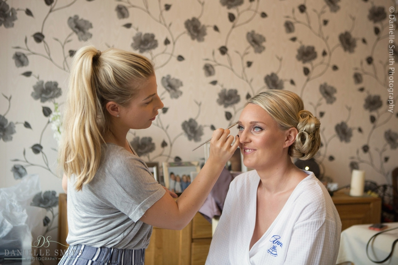 bride having her make up done at home