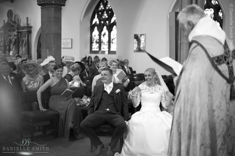 bride and groom laughing during church service