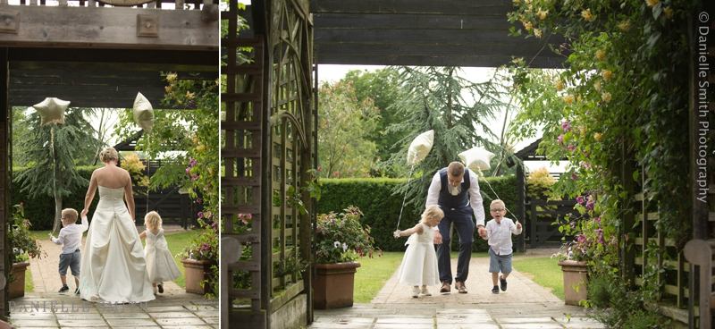 bride and groom with page boy and flower girl