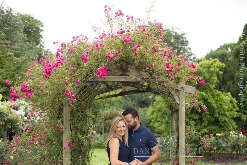 couple under pink flower pergola in southend