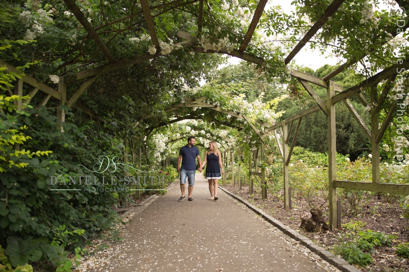couple waling under pergola in southend