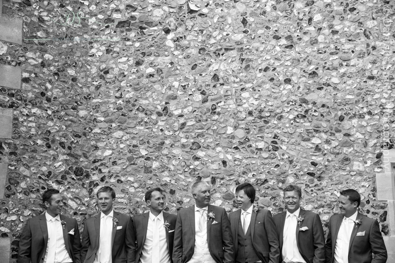 groom and groomsmen outside the church wall