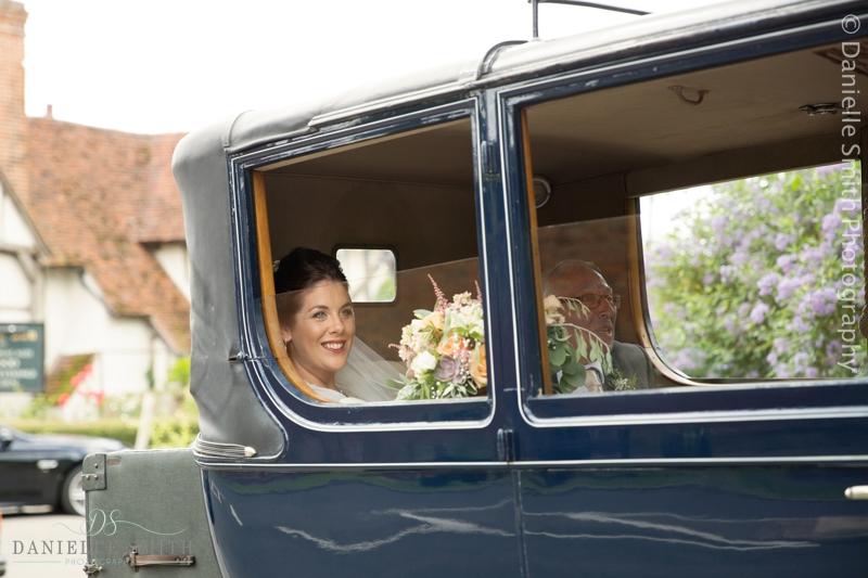 bride arriving in vintage car