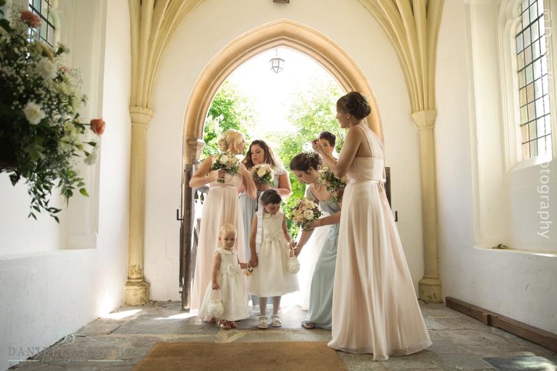 bride and bridesmaids waiting in church doorway