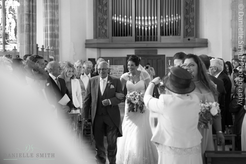 bride and her father walking down aisle