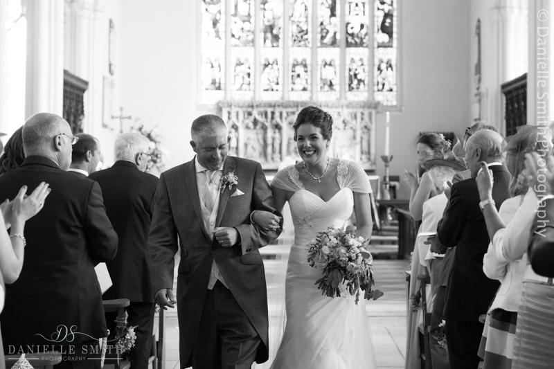 bride and groom walking down aisle - creative documentary wedding photography
