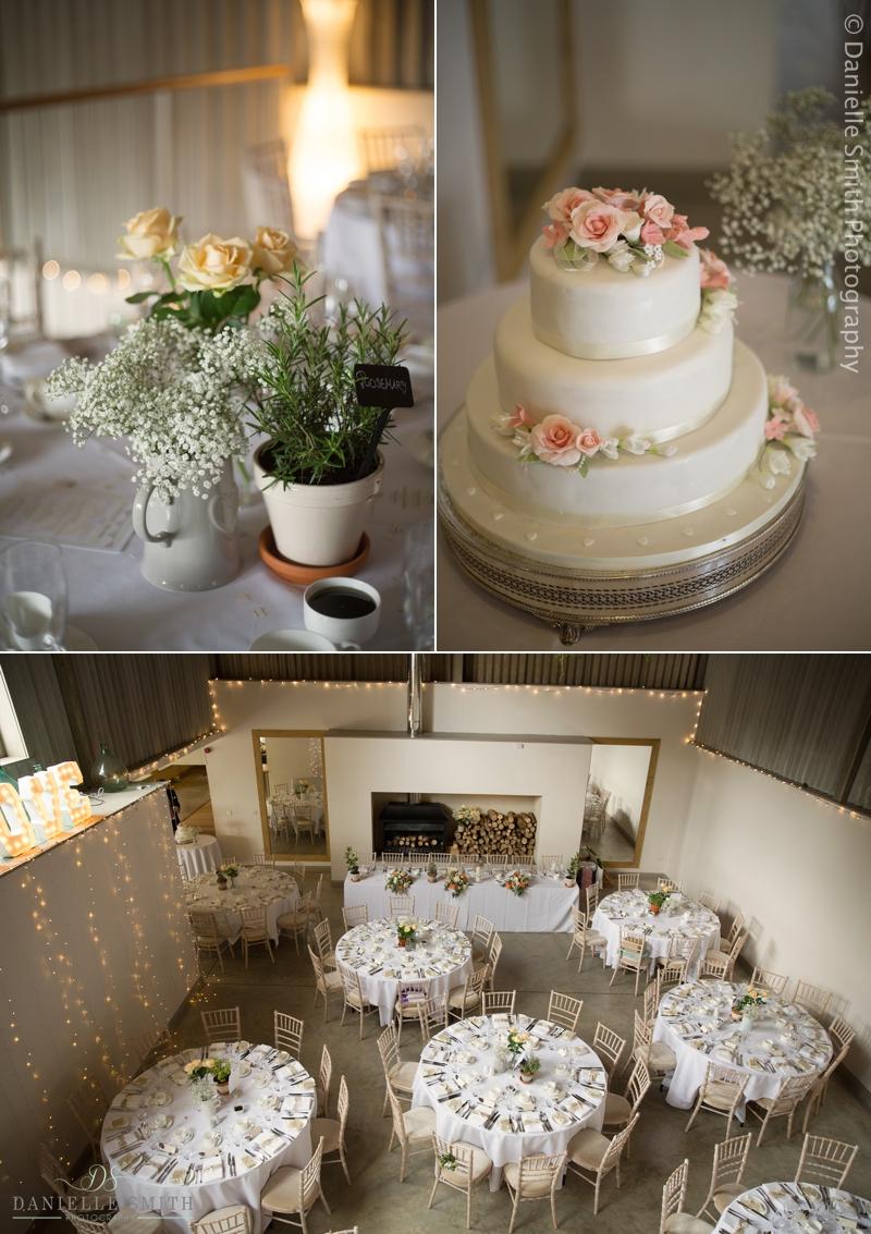 herb table decor and wedding cake
