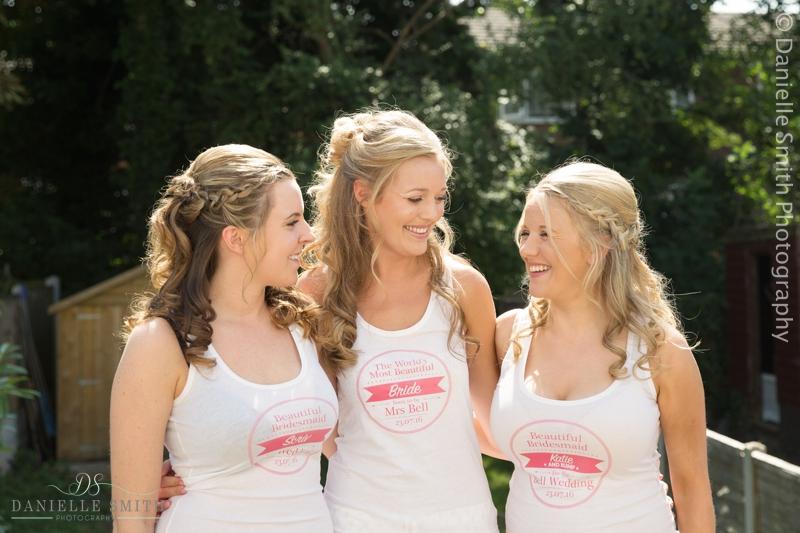 bride and bridesmaids wearing wedding t shirts