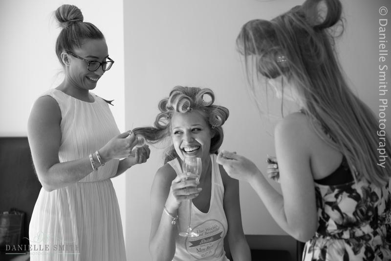 bride laughing having hair and make up done - old brook barn wedding