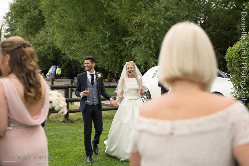 bride and groom arriving at old brook barn wedding
