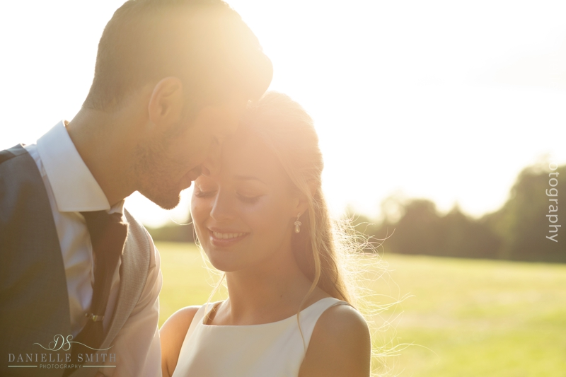 bride and groom close portrait at sunset