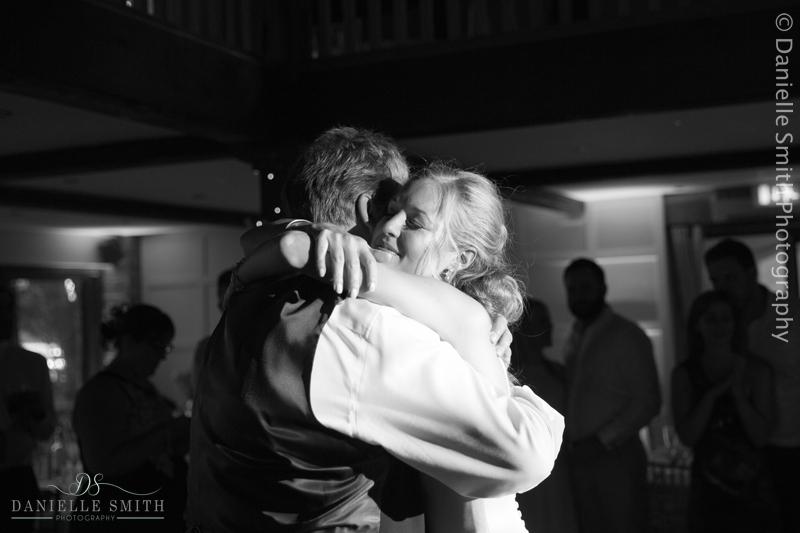 bride hugging her dad on dance floor