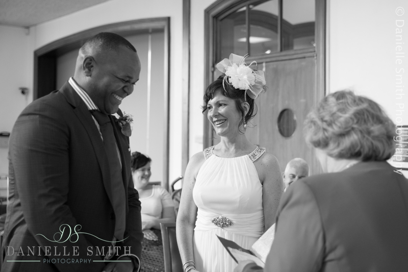 bride and groom laughing during vows