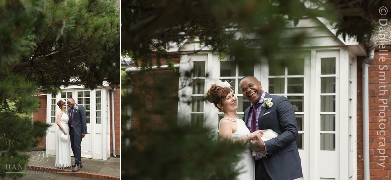 bride and groom laughing outside doors
