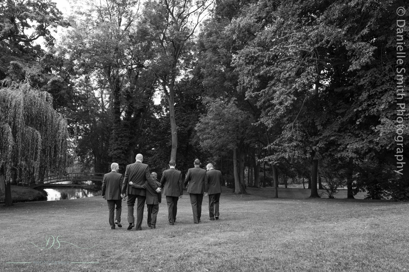 groom and son and groomsmen walking away