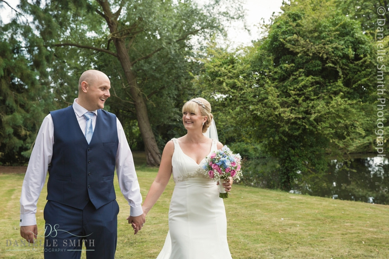 bride and groom holding hands - mulberry house wedding