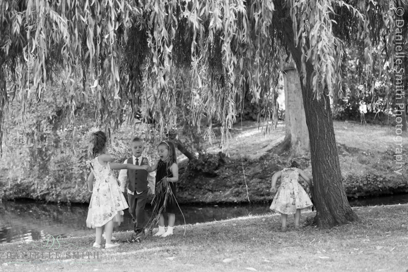 kids playing under willow tree