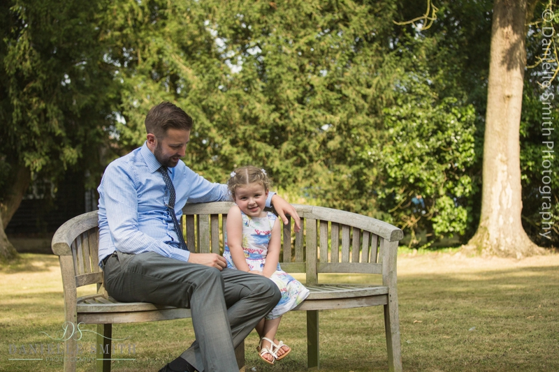 father and daughter sitting on bench - mulberry house wedding