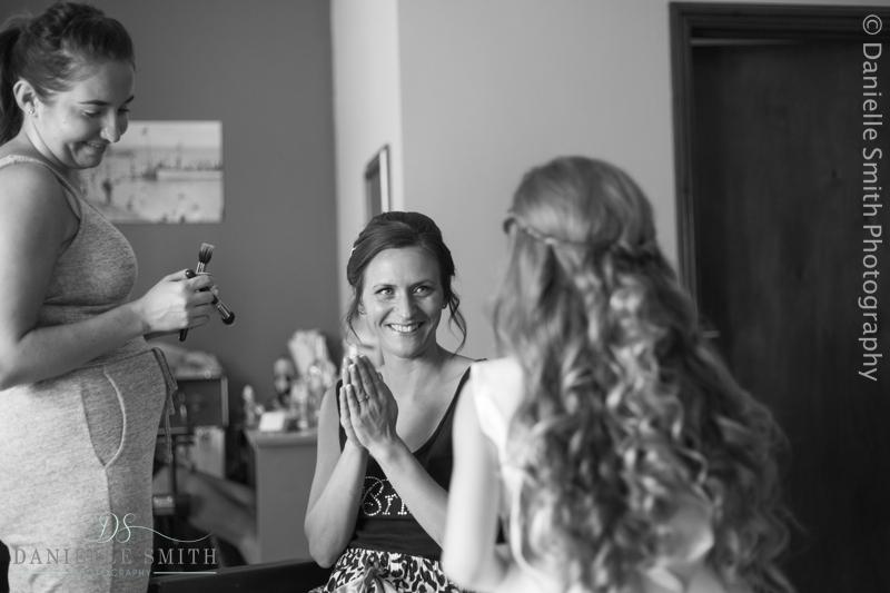 bride seeing her daughter as flower girl