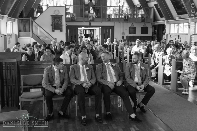 groom and groomsmen waiting in church