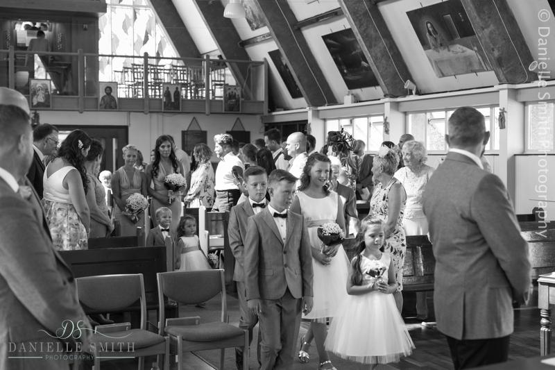 bridal party walking down aisle - arlington ballrooms wedding