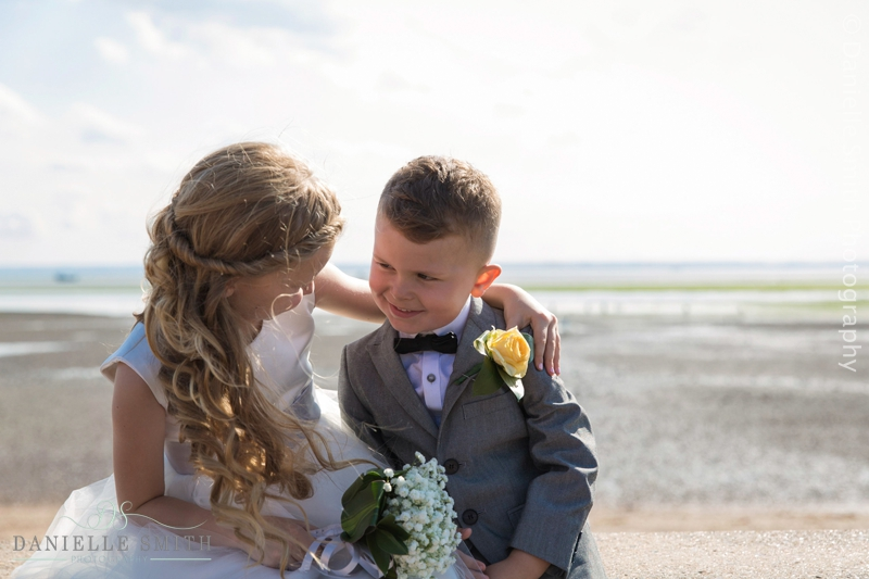 flower girl and page boy at beach wedding