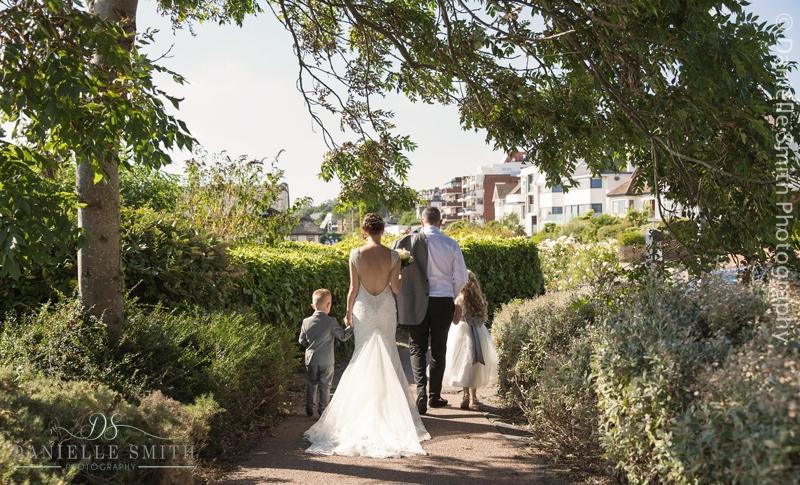 bride and groom and children walking away