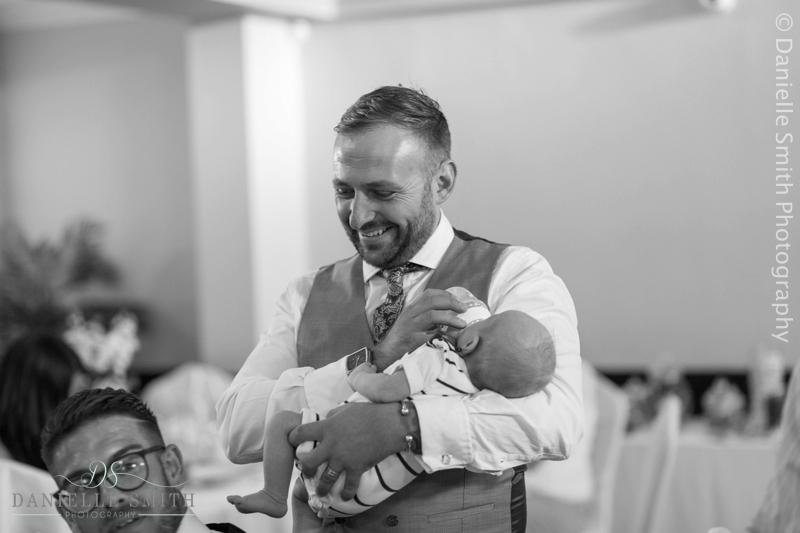 wedding guests feeding baby
