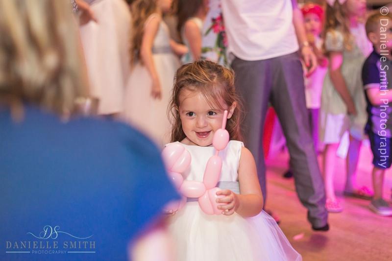 little girl with dog balloon - arlington ballrooms wedding