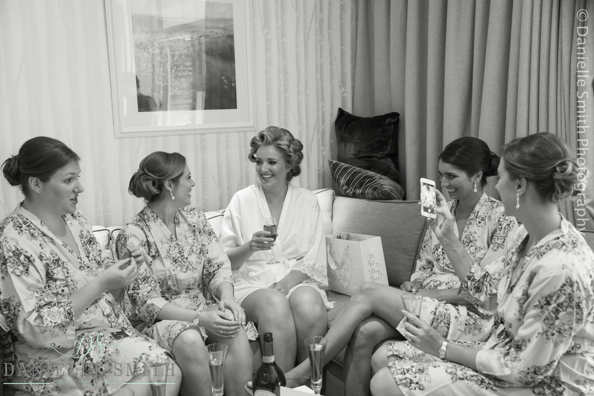 bridesmaids sitting around in robes