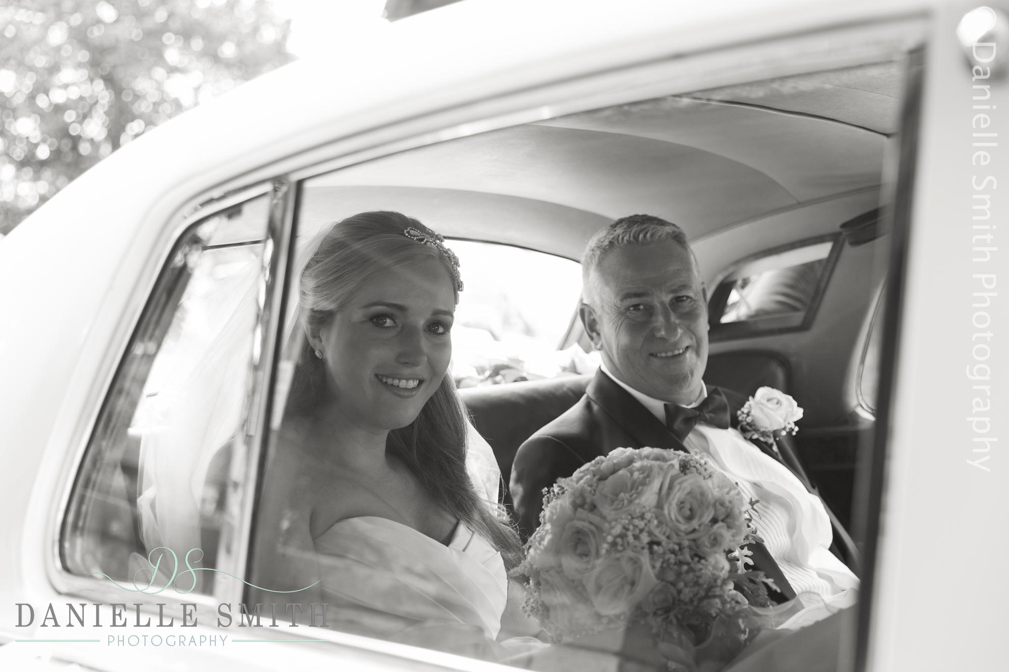 bride and her dad through car window