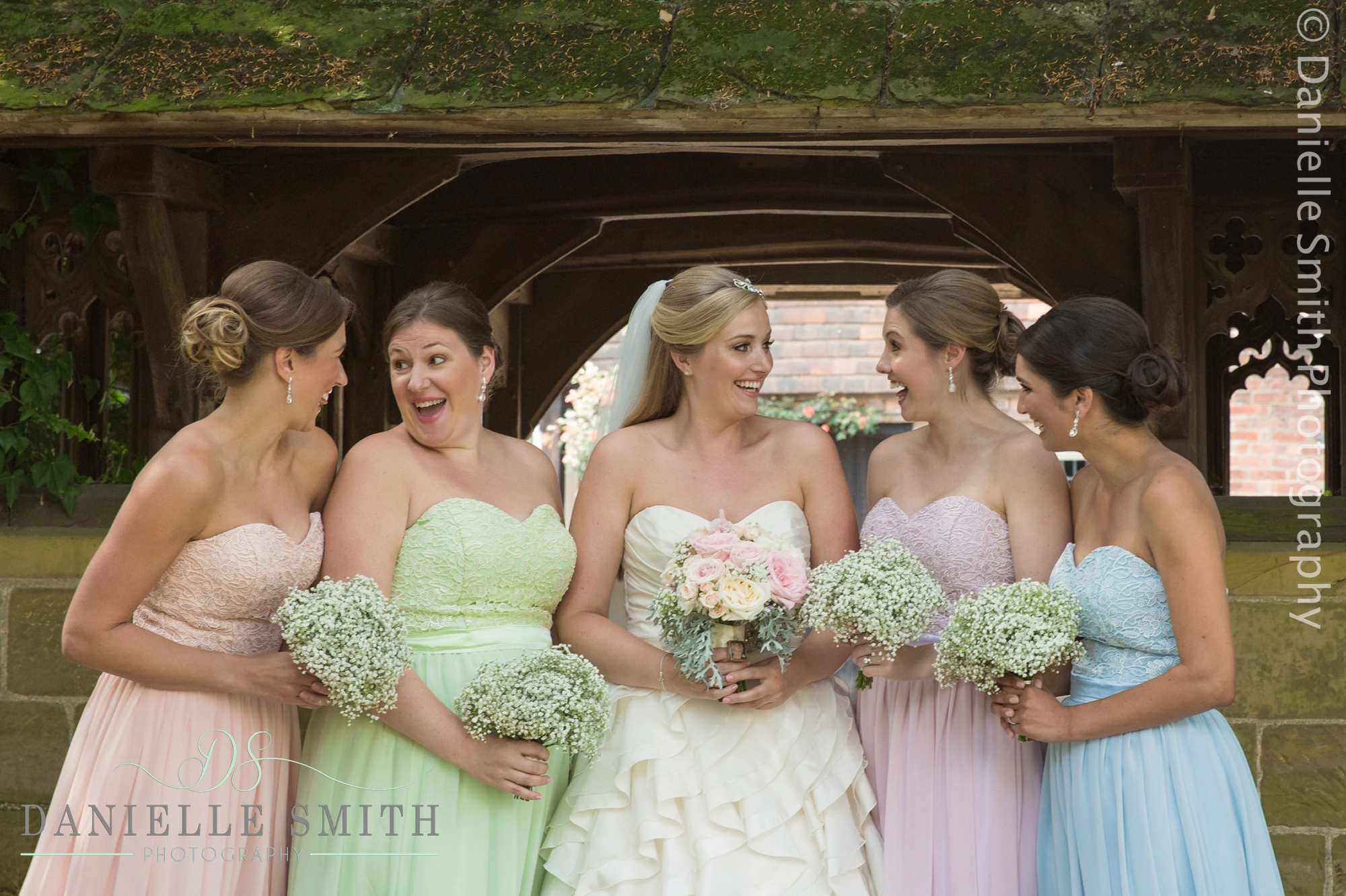 bride and bridesmaids in colourful dresses